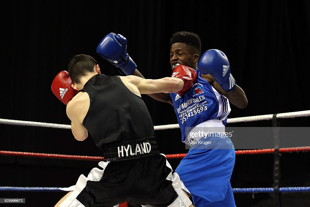 Muzzy Fuyana(blue) in action against Blane Hyland in their 52kg fight during day one of the Boxing Elite National Championships at Echo Arena on April 29, 2016 in Liverpool, England.