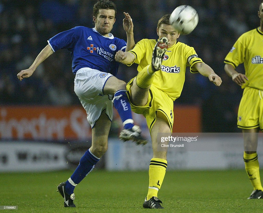 Muzzy Izzet of Leicester and Matt Holland of Charlton both go for the ball during the FA Barclaycard Premiership match between Leicester City and Charlton Athletic at Walkers Stadium on Novermber 22, 2003 in Leicester, England.