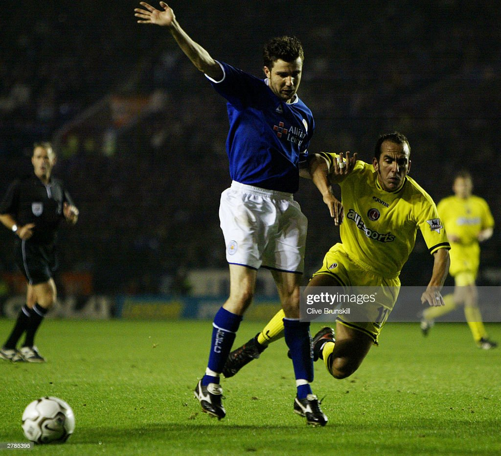 Muzzy Izzet of Leicester City holds off Paolo Di Canio of Charlton Athletic during the FA Barclaycard Premiership match between Leicester City and Charlton Athletic on Novermber 22, 2003 at Walkers Stadium in Leicester, England. The match ended in a 0-0 draw.