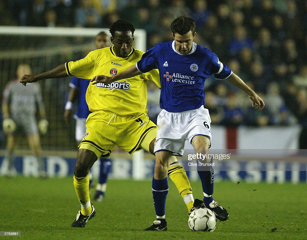 Muzzy Izzet of Leicester holds off Jason Euell of Charlton during the FA Barclaycard Premiership match between Leicester City and Charlton Athletic at Walkers Stadium on Novermber 22, 2003 in Leicester, England.