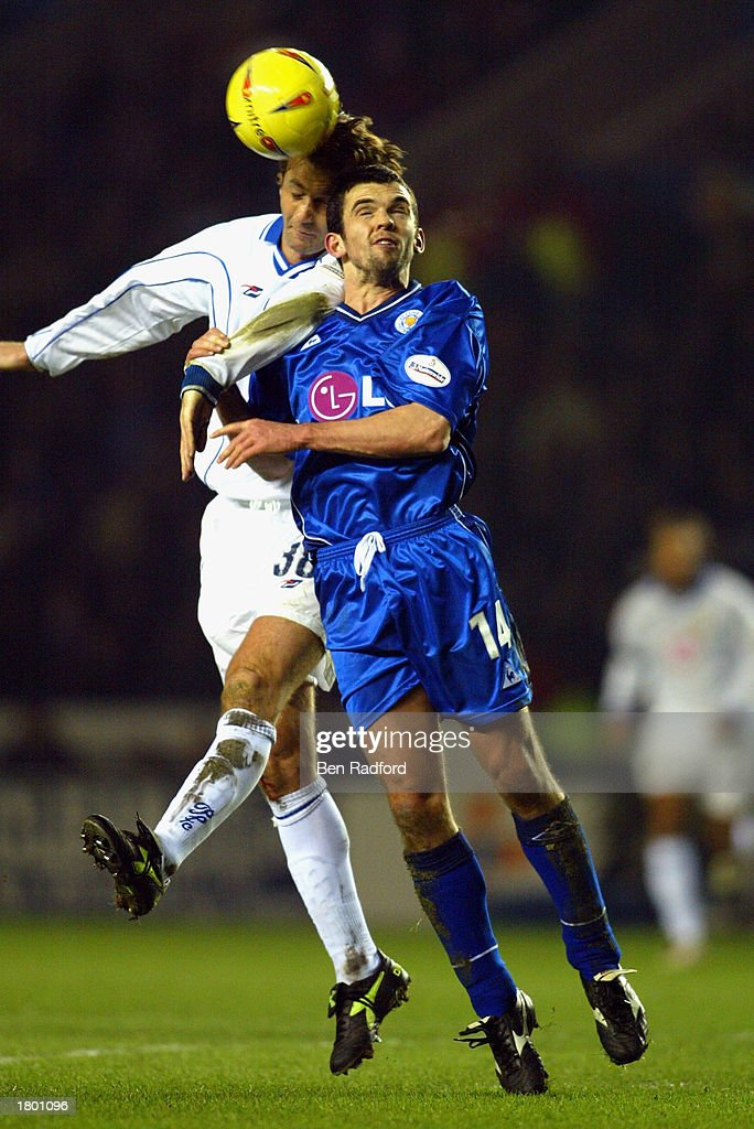 Muzzy Izzet of Leicester jumps for the ball with Tim Sherwood of Portsmouth during the Nationwide League Division One match between Leicester City and Portsmouth at Walkers Stadium, Leicester, England on February 17, 2003.