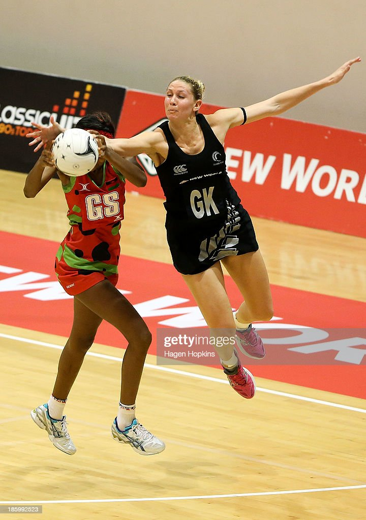 Mwai Kumwenda of Malawi and Casey Kopua of New Zealand compete for the ball during the International Test Match between the New Zealand Silver Ferns and the Malawai Queens at Pettigrew Green Arena on October 27, 2013 in Napier, New Zealand.