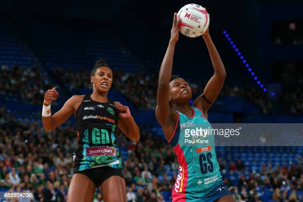 Mwai Kumwenda of the Vixens catches a pass against Stacey Francis of the Fever during the round 14 Super Netball match between the Fever and the...