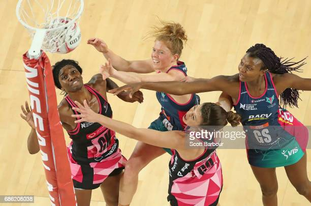 Mwayi Kumwenda and Tegan Philip of the Vixens and Ama Agbeze and Fiona Themann of the Thunderbirds compete for the ball during the round 13 Super...