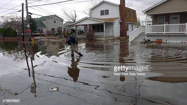 My husband Steve Chin in waders on our block Utica Walk in Breezy Point which suffered severe damage by Hurricane SandyOur house had 5 feet of water...