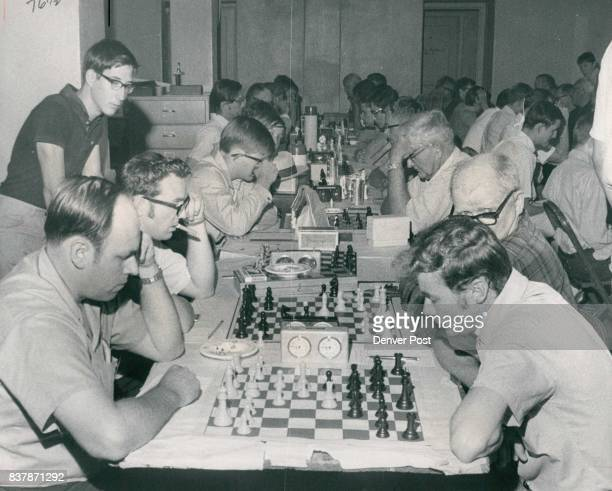 My Move Eh Now Let Me See Participants in the annual Labor Day weekend Colorado Open Chess Tournament concentrate over their game boards Saturday...