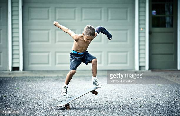 My son practicing skateboarding in our driveway He needed to stay active with his broken arm