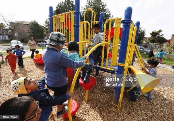 Mya and Joshua Senthilnathan go for a slide as kindergarten students at Mary Shadd Public School tested out their new playground installed at the...