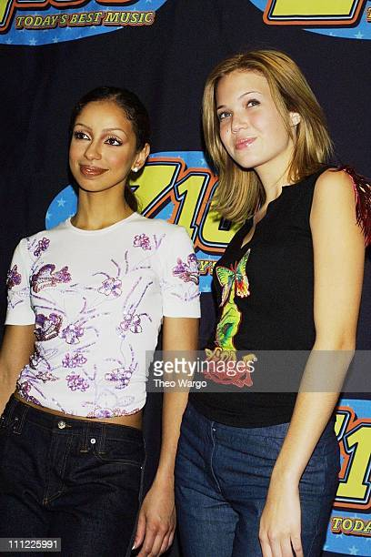 Mya and Mandy Moore during Z100 Jingle Ball 2000 Concert at Madison Square Garden in New York City New York United States