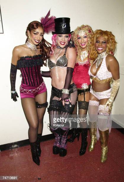 Mya Pink Christina Aguilera and Lil' Kim during My VH1 Music Awards 2001 Backstage at the The Shrine Auditorium in Los Angeles California