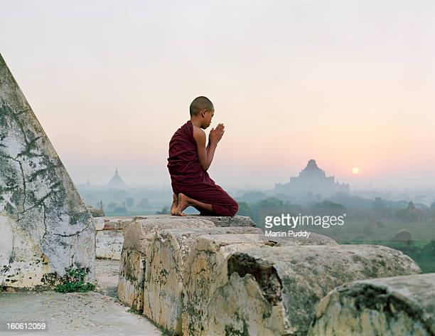 Myanmar, Bagan, Buddhist monk praying on temple