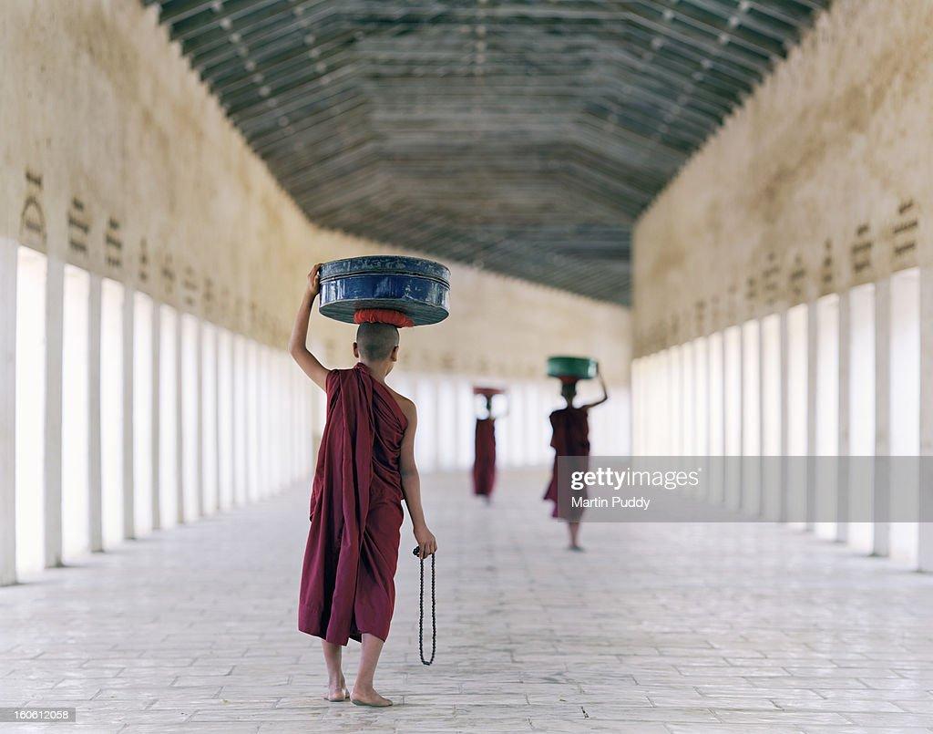 Myanmar, Bagan, monks in temple corridor : Stock Photo