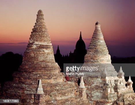 Myanmar, Bagan,Buddhist monk on temple at dawn : Stock Photo