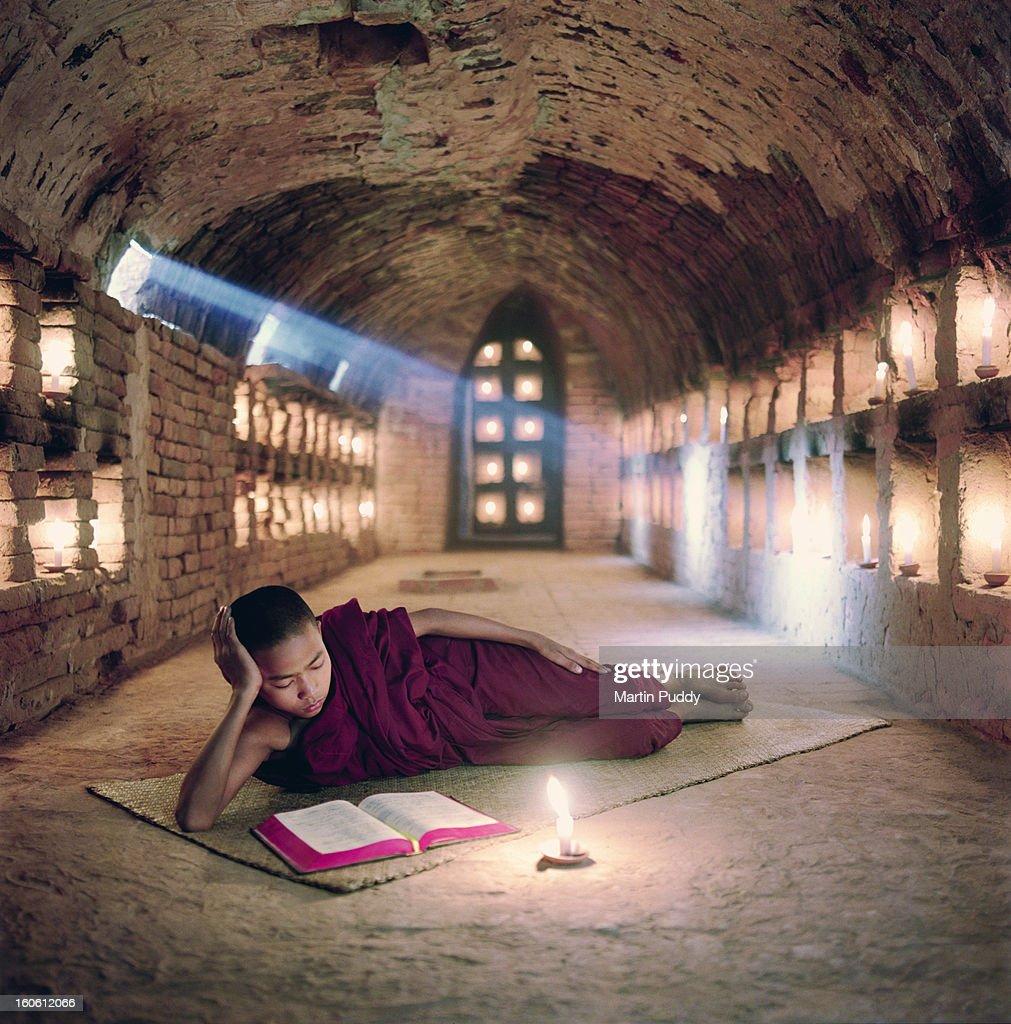 Myanmar, Buddhist monk inside meditation hall : Stock Photo