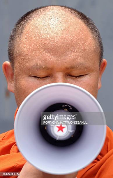 A Myanmar buddhist monk reads a statment during a demonstration in front of Myanmar embassy in Bangkok on May 20 2009 Myanmar allowed reporters and...