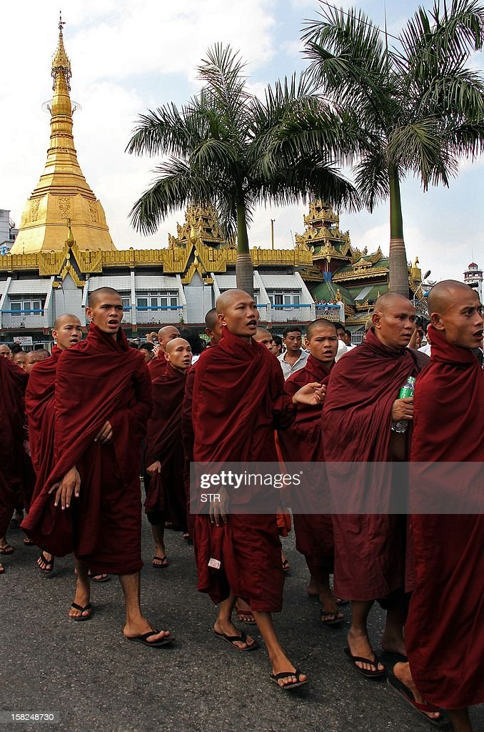 Myanmar Buddhist monks stage a protest demanding further apologies over injuries sustained by clerics in a police crackdown on a rally at a Chinese-backed copper mine last month, in Yangon on December 12, 2012. Hundreds of monks staged protests across Myanmar in the latest display of public discontent over the incident at the mine in Monywa, northern Myanmar. AFP PHOTO