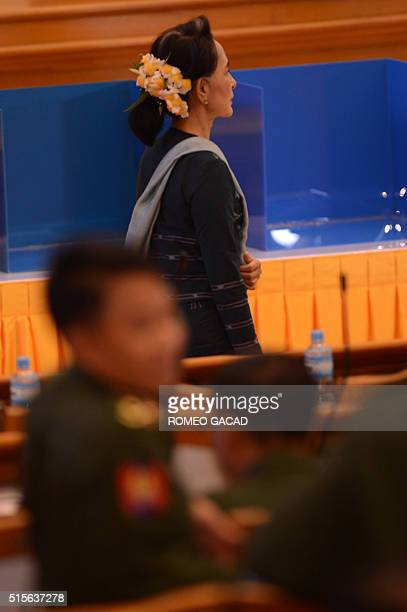 Myanmar democracy icon Aung San Suu Kyi arrives at the parliament as members of parliament from the military faction also gather for the historic...