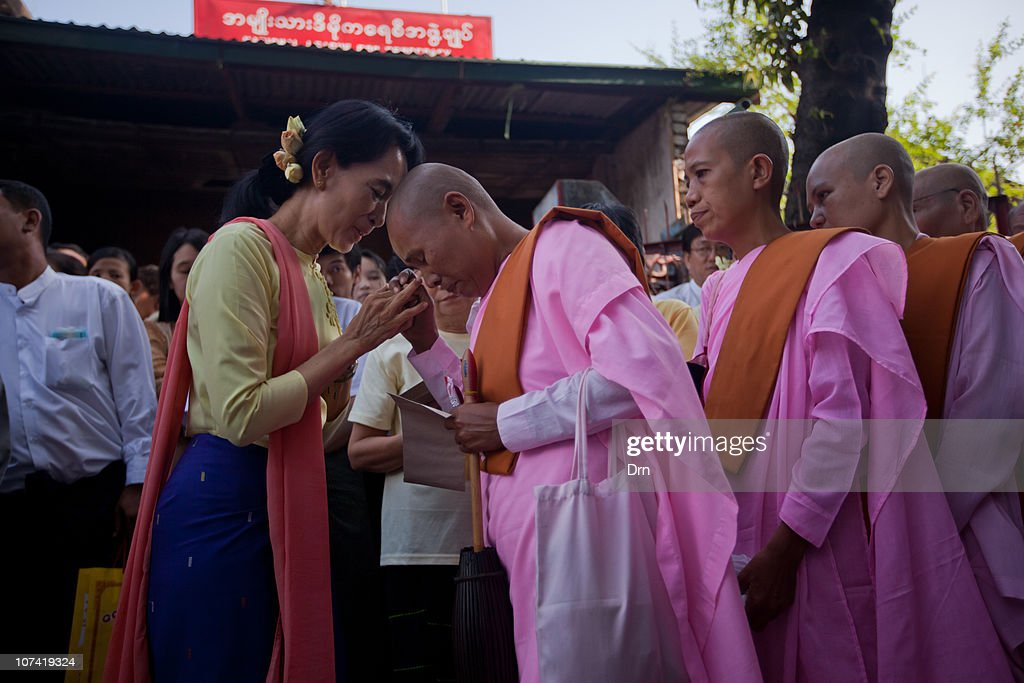 Myanmar democracy icon Aung San Suu Kyi hands out donations to Buddhist nuns at the National League for Democracy headquarters in Yangon on December...