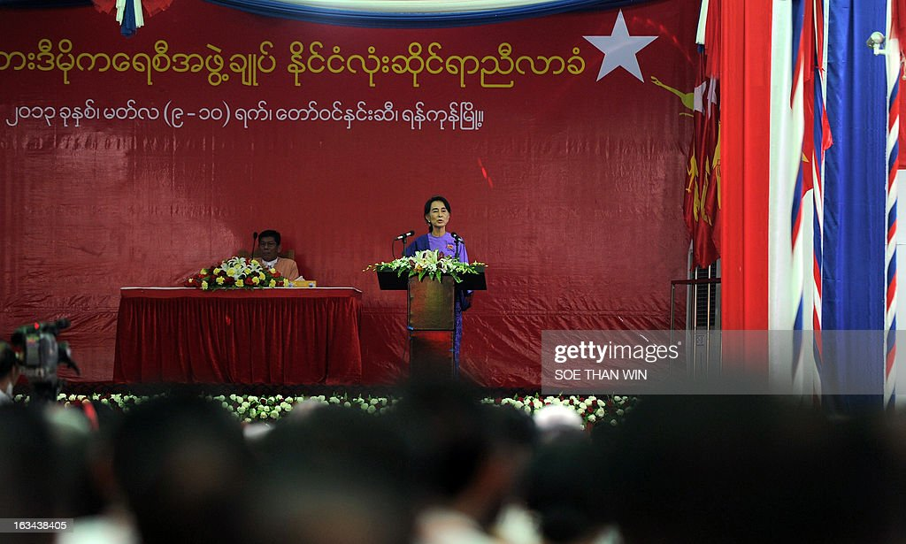 Myanmar democracy leader Aung San Suu Kyi (C) delivers a speech during the National League for Democracy's (NLD) first ever party conference at the Royal Rose Hall in Yangon on March 10, 2013. Myanmar's long-silenced opposition on March 10 reappointed Nobel laureate Aung San Suu Kyi as party leader at a landmark maiden congress, as it eyes victory in elections due in 2015. AFP PHOTO / Soe Than WIN
