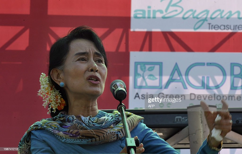 Myanmar democracy leader Aung San Suu Kyi speaks to onlookers as she attends a fund raising drive for the education network for her National League for Democracy (NLD) party in Yangon on December 27, 2012. AFP Photo/ YE AUNG THU