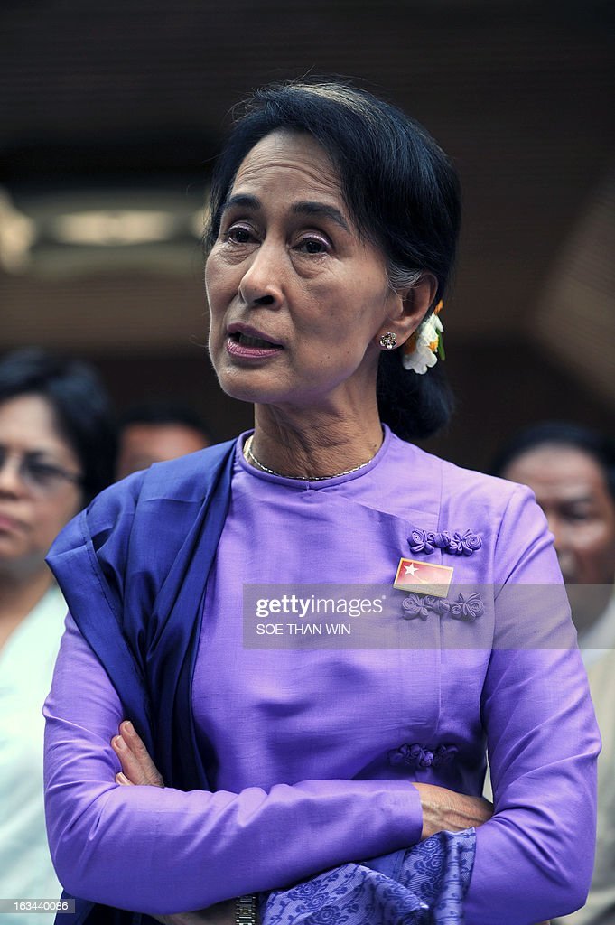 Myanmar democracy leader Aung San Suu Kyi speaks to the media at a press conference during the National League for Democracy's (NLD) first ever party conference at the Royal Rose Hall in Yangon on March 10, 2013. Myanmar's long-silenced opposition on March 10 reappointed Nobel laureate Aung San Suu Kyi as party leader at a landmark maiden congress, as it eyes victory in elections due in 2015. AFP PHOTO / Soe Than WIN