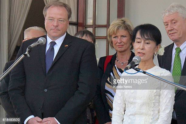 YANGON Myanmar Dirk Niebel Germany's minister of economic cooperation and development and Myanmar democracy icon Aung San Suu Kyi hold a joint press...