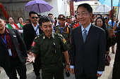 Myanmar ethnic rebel leader General Gun Maw from the Kachin Independence Army walks with Chinese Special Envoy Sun Guoxiang as leaders and...