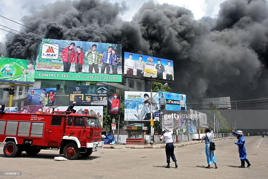 Myanmar firemen arrive to fight a blaze that broke out at the main market in Yangon on May 24 , 2010. A huge fire broke out at the main market in Myanmar's biggest city Yangon destroying hundreds of shops, but no victims were reported, shop owners and officials said.