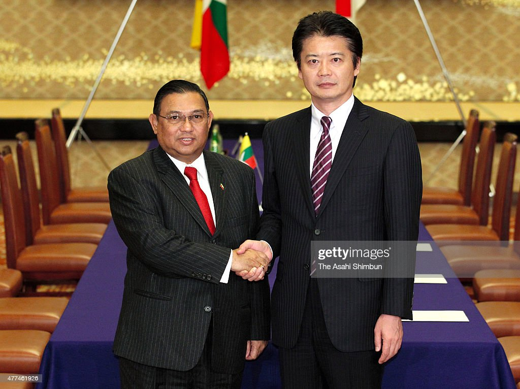 Myanmar Foreign Minister Wunna Maung Lwin (L) and Japanese Foreign Minister <a gi-track='captionPersonalityLinkClicked' href=/galleries/search?phrase=Koichiro+Gemba&family=editorial&specificpeople=7046304 ng-click='$event.stopPropagation()'>Koichiro Gemba</a> shake hands during their meeting at the Iikura Guest House on October 21, 2011 in Tokyo, Japan.