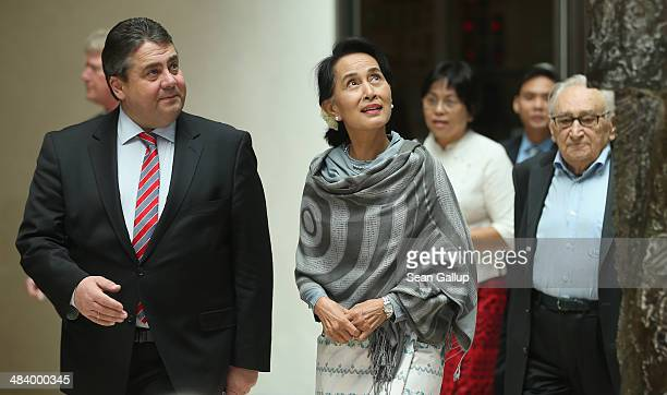 Myanmar human rights activist and politician Aung San Suu Kyi arrives with Vice Chancellor and Economy and Energy Minister as well as Chairman of the...