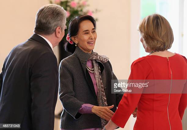 Myanmar human rights activist and politician Aung San Suu Kyi greets German President Joachim Gauck and First Lady Daniela Schadt upon her arrvial at...