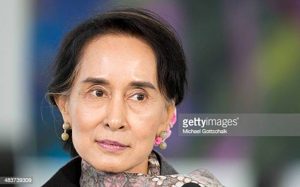 Myanmar human rights activist and politician Aung San Suu Kyi poses as she meets German Chancellor Angela Merkel in the Chancellery on April 10 2014...