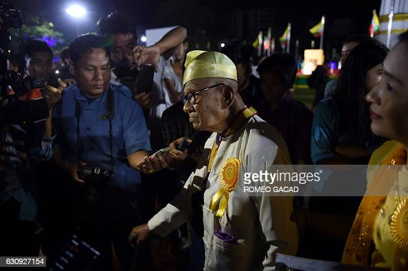 Myanmar independence veteran and grandfather Ba Tin is interviewed by journalists after participating in a dawn flagraising ceremony at Yangon's...