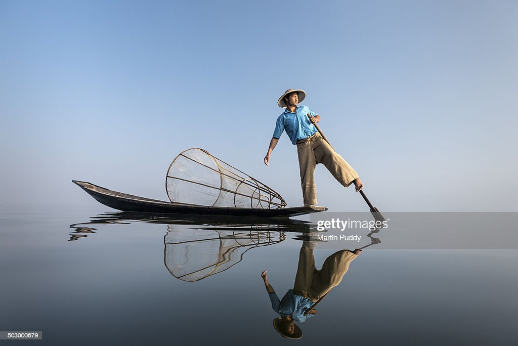 Myanmar, Inle lake, traditional fisherman on boat