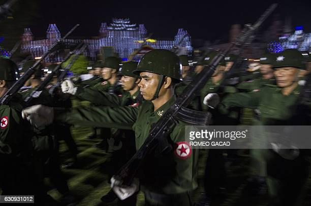 A Myanmar military honour guard parades with bayonetmounted rifles during a dawn flagraising ceremony at Yangon's central Mahabandoola Park on...