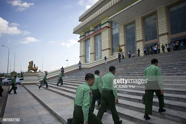 Myanmar military officials arrive for Myanmar's first parliament meeting after general elections at the Lower House of Parliament in Naypyidaw on...