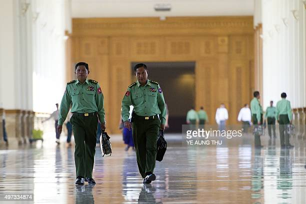 Myanmar military officials arrive for the first parliament meeting after general elections at the Union Parliment in Naypyidaw on November 16 2015...