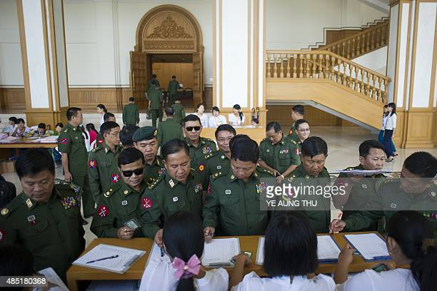 MACNAMARA Myanmar military pesonnel sign a registration book as they arrive for a regular session of the Union Parliament in Naypyidaw on August 25...
