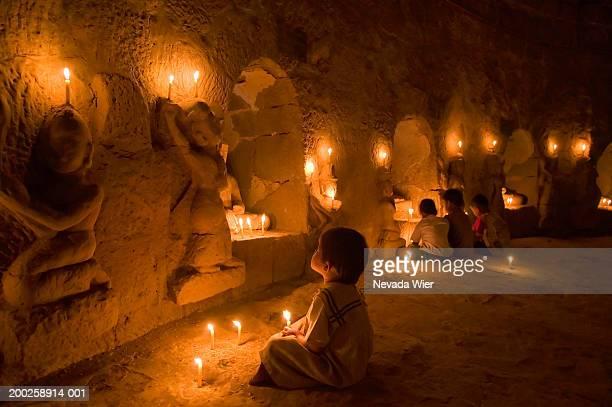 Myanmar, Mrauk-U, Htukkam Thein Paya, children praying, rear view