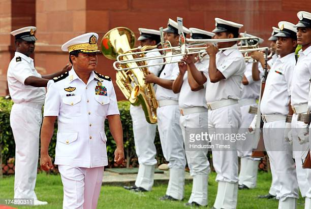 Myanmar Navy CommanderInChief Vice Admiral Thura Thet Swe inspects a Guard of Honour prior to a meeting with Indian Navy Chief Admiral DK Joshi on...