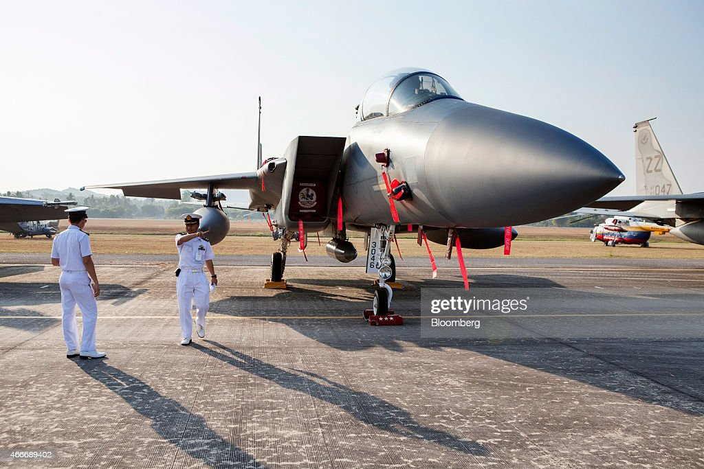 Myanmar Navy officers look at a United States Air Force F15 Strike Eagle a muiltirole fighter aircraft manufactured by Boeing Co at the Langkawi...