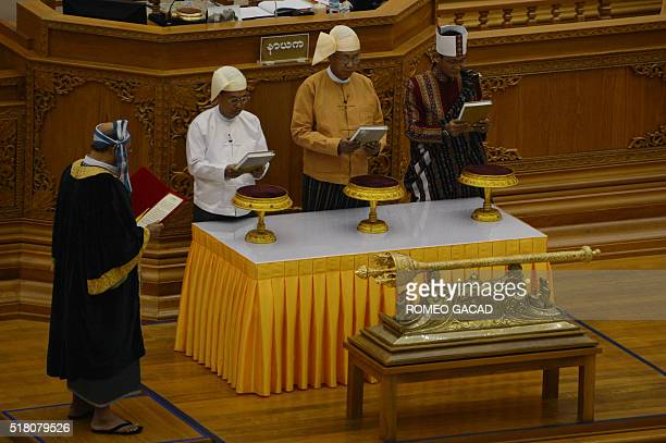 TOPSHOT Myanmar new President Htin Kyaw flanked by Vice Presidents Myint Swe and Henry Van Thio is sworn in by House Speaker Mahn Win Khine Than...