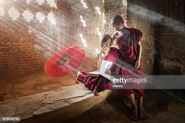 Myanmar Novice Monks Together Reading Buddhist Book Bagan