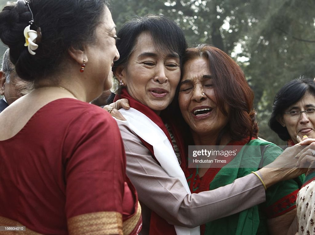 Myanmar opposition leader and National League for Democracy Chairperson Aung San Suu Kyi hugs one of her old classmate during her visit to Lady Sri Ram College, her alma mater on November 16, 2012 in New Delhi, India.