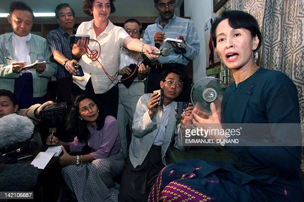 Myanmar opposition leader and Nobel Peace Price laureate Aung San Suu Kyi gestures while addressing an impromptu press conference 25 February Suu Kyi...