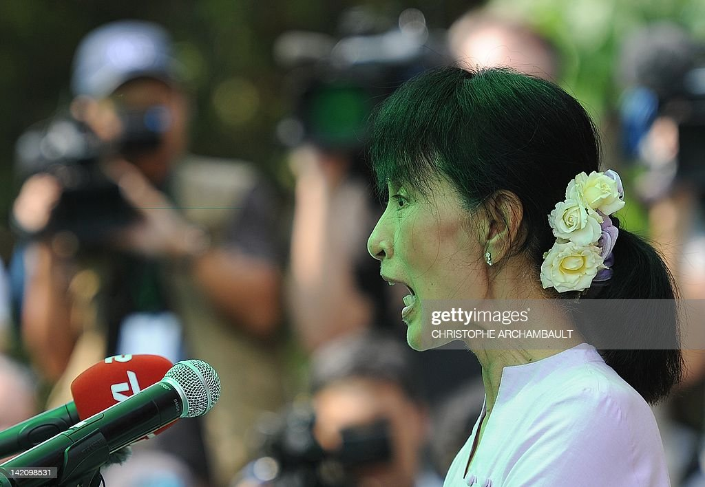 aung san suu kyi thesis Thesis & background coming home to rebellion aung san suu kyi pointing out at the crowd during her speech at shwedagon pagoda.
