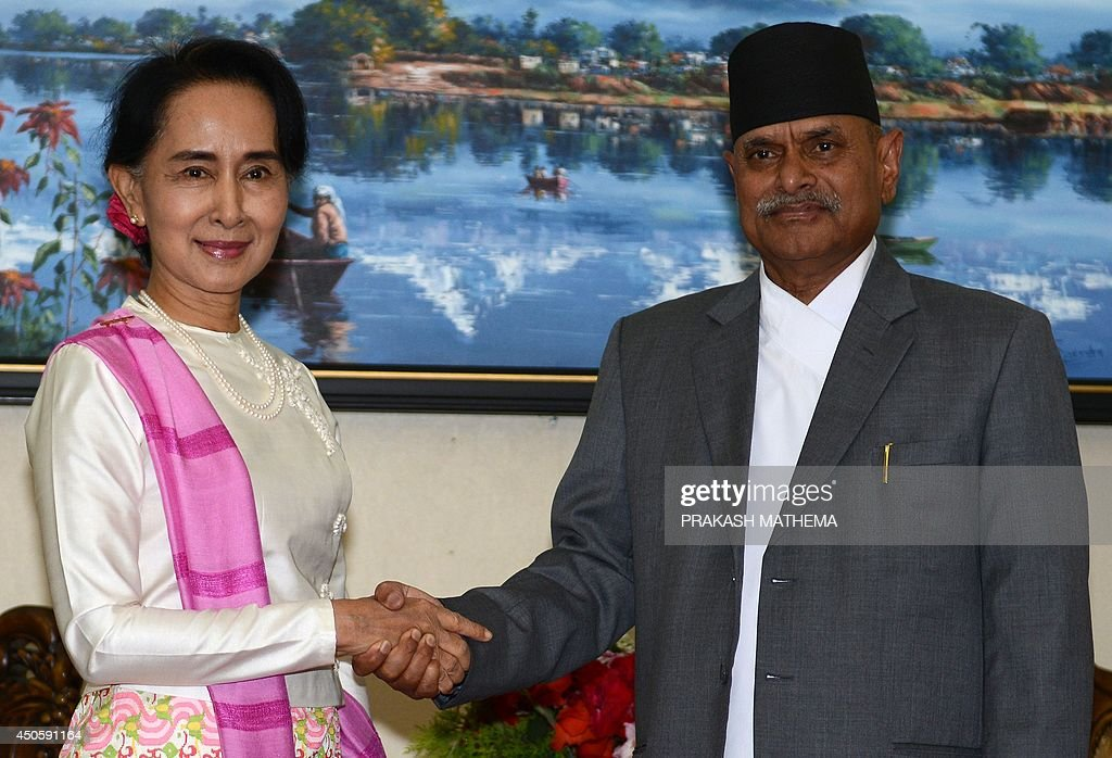 Myanmar opposition leader Aung San Suu Kyi (L) and Nepalese President Ram Baran Yadav shake hands during a meeting at the Office of the President in Kathmandu on June 14, 2014. Suu Kyi is on a four-day visit to Nepal. AFP PHOTO/Prakash MATHEMA