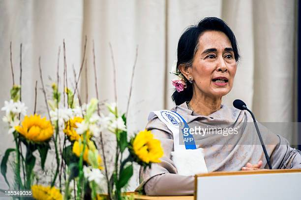Myanmar opposition leader Aung San Suu Kyi delivers a speech during a conference entitled 'Charity and compassion in Europe' at the UCL university in...