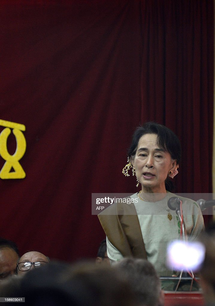 Myanmar opposition leader <a gi-track='captionPersonalityLinkClicked' href=/galleries/search?phrase=Aung+San+Suu+Kyi&family=editorial&specificpeople=214208 ng-click='$event.stopPropagation()'>Aung San Suu Kyi</a> delivers a speech to mark the 65th anniversary of Myanmar's independence at the head office of the National League for Democracy (NLD) party in Yangon on January 4, 2013. Myanmar, formerly known as Burma, gained independence from Britain on January 4, 1948. AFP PHOTO / YE AUNG THU