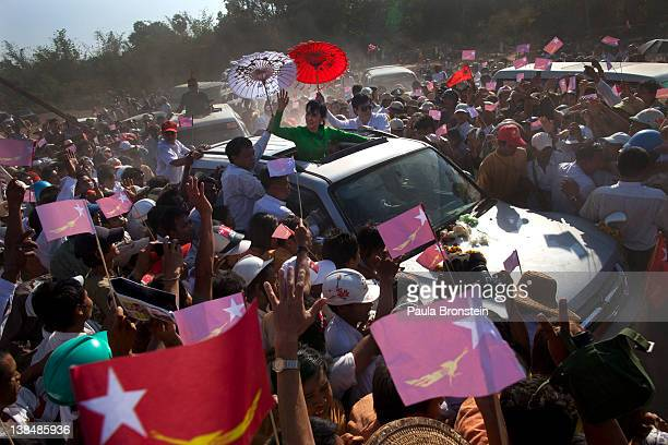 Myanmar opposition leader Aung San Suu Kyi greets the crowds from the top of a vehicle during campaigning in the Delta region on her second campaign...